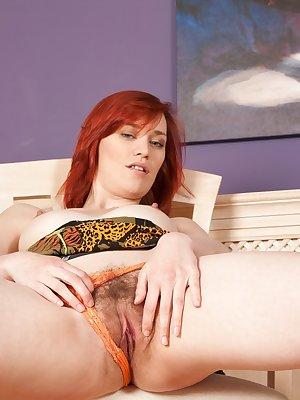 Sexy redhead Leanne pulls her panties to the side and shows off her gorgeous hairy bush to the world for the first time.