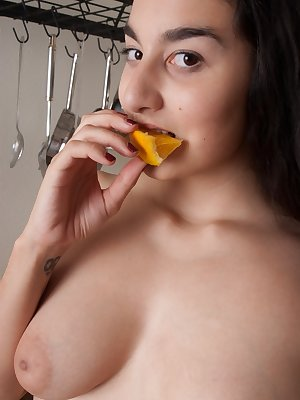 Wara quickly strips down to her sexy curvy body in the kitchen and slowly eats a slice of orange. Her supple lips drip of juices as she finishes it.<br />