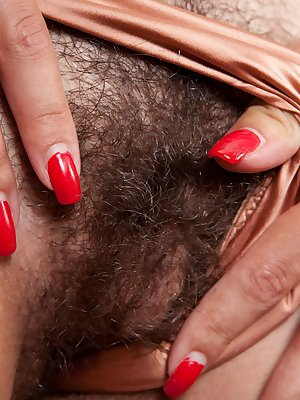 This sexy hairy nympho has a hairy pussy that will break your heart. Be prepared for when her dress hits the ground and she slowly opens her tight legs.