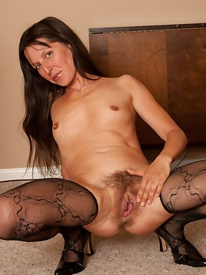 Slender sexy mature Carmen is one of a kind. Her tight firm body complements her sexy dress and looks even better on the floor when she gently pulls her hairy pussy open.
