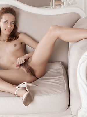 Mimi Lea is relaxing and stripping naked on her sofa. She is beautiful while naked and shows the camera her hairy bush. She spreads her legs and invites you to stare at her hairy pussy to the end.