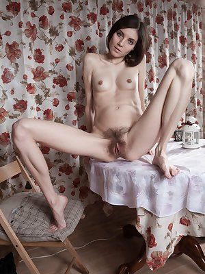Maia is lighting a candle and enjoying it as she strips naked. As she strips naked, you can see her hairy pits and hairy bush. She enjoys her pussy all over the table, and puts on a sexy time.