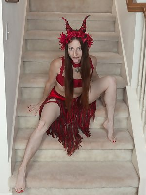 Evane Nordstern is in all red on her stairs and feeling extra sexy. She has hairy pits and as she strips naked a nice hairy pussy. She spreads her legs showing her natural body and looks lovely.
