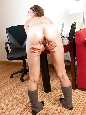 With her cute tiny ass bent over her desk, Sophia slides her middle finger deep in to her throbbing hairy pussy. What are you waiting for? she likes it when you watch!