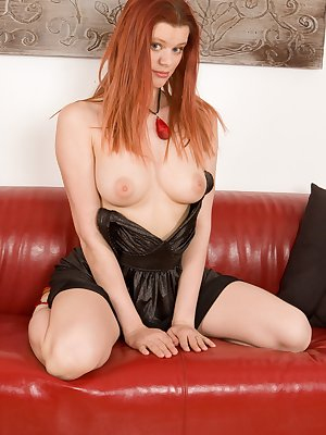 Sexy redhead Benji is here and ready to please. Sit back and relax as she slowly peels out of her sexy dress on the cold leather couch, before her thick vibrator insertion.