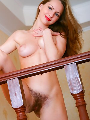 The lovely natural Irina S is so hot thinking of all the things you could do to her. She can't wait so she begins to play with her bush all alone.