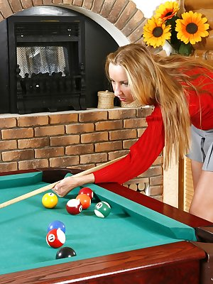 The game comes to a stand still when Julia gets out her thick curly pussy, and tugs on her blonde bush. Want her to play with your balls too?