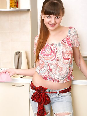 Seductive Helen is doing the dishes in some sexy ripped jeans. Her mind starts to wander, and ends up playing with her moist warm hairy pussy with a cold metal spoon.