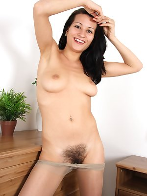 All natural Laura cant wait to get out of her sexy mini skirt and hair restricting stockings. She quickly rips a hole in her pantyhose to reveal her thick hair and meaty vagina