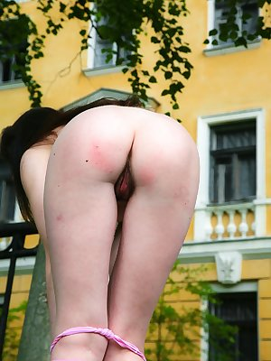 Follow Anna R outside as she finds a quiet spot to peel off her clothes one-by-one. She's excited about revealing her sweet, hairy pussy outdoors - the gentle breeze caresses her lips.