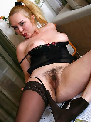 Camelia settles down at home and is tired of work...tasting her favorite candy makes her hairy pussy hot and moist.