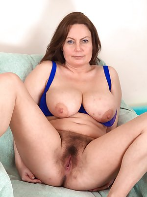Alexis May strips off her sexy blue lingerie
