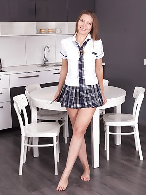 Ewangi strips naked in her kitchen on her table