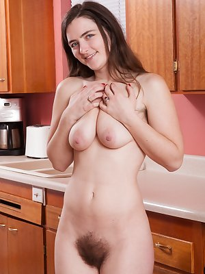 Snow strips naked in her kitchen