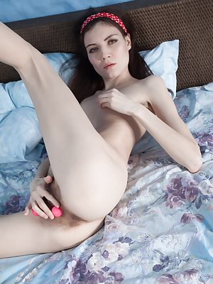 In her red dress, Maia is looking 26 and very sexy. She shows off her hairy pits before stripping naked in bed for the camera. She gets some toys and starts masturbating and orgasming.