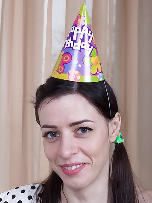 Maria Rosa is celebrating her birthday with a cake. She enjoys it and wants to masturbate to celebrate. She strips and gets her new purple vibrator she bought and masturbates by fucking her pussy.