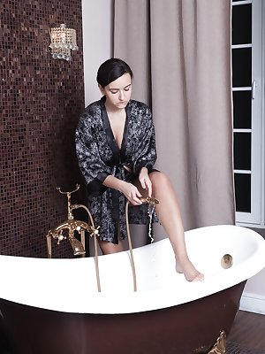 Ramira takes off her robe and lingerie before sliding into her bath. Before getting in, she touches her beautiful 34C breasts, strokes her hairy pussy and enjoys her naturally hairy body.