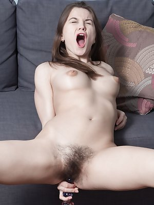 Evelina Darling is elegant in her black lingerie and picks her favorite sex toy. She undresses and spreads her legs. The glass dildo slides inside her hairy pussy and the dildo is fucked deep inside.