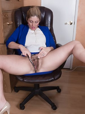 In her office, Alicia Silver is showing off her body in her blue and white suit. She has her dildo nearby, so she gets naked and masturbates. It fucks her hairy pussy deeply and she gets wet.