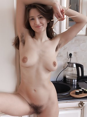 Shivali enjoys sushi and is doing so in her white dress in her kitchen. After, she strips naked and loves to show off her hairy figure. She grabs her chopsticks and uses them on her hairy pussy.