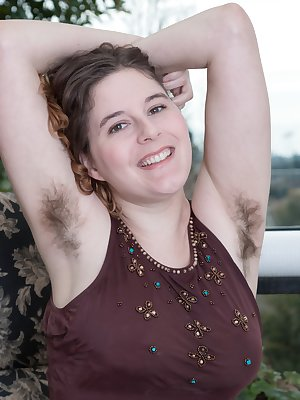 Eleanor Rose is on her balcony wearing brown, and showing us her hairy pits early. She lays back on her chair after stripping nude, and shows us her hairy pussy. She touches it all over and enjoys it.