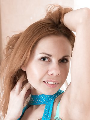 Liliya is showing off her blue dress in her bedroom and has stockings on as well. She undresses and gets on her bed to show off her body. Her full hairy pussy gets our attention and yours too we bet.