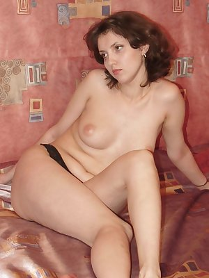 Pretty amateur model totally naked in front of the camera while examining her hirsute cunt