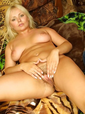 Chubby and busty seductress sensually masturbates her furry fuckhole.