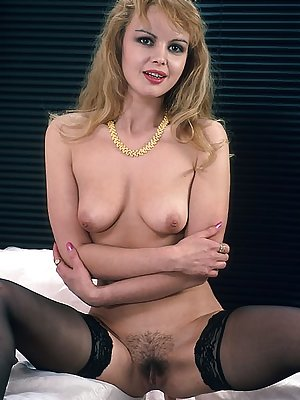 Pretty-faced small tits blonde spreading wide exposing her bushy cunt