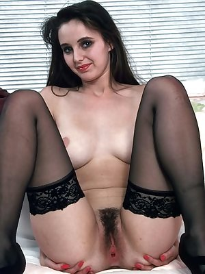 Slim dark-haired stockings babe showing hairy pussy wanting to be fucked