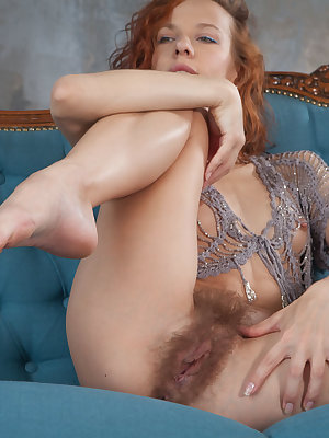 Natural redhead Dennie shows her small tits and an extremely hairy pussy