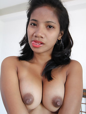 Filipino female with pointy boobs tries her hand at modeling in the nude
