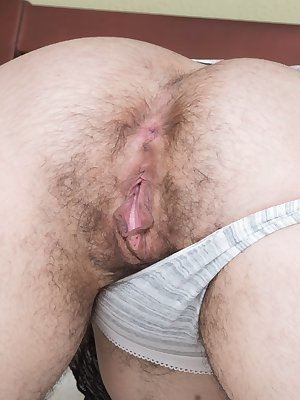 Dark haired Wara removes her pants to show an amazingly hairy beaver & ass