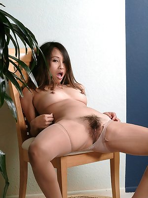 Cute Latina first timer Sexual rolling down pantyhose to expose hairy cunt