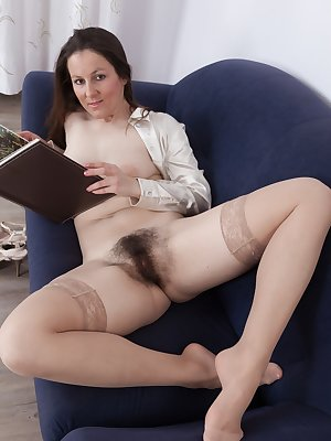 Valentina Ross is relaxing on her couch and feeling horny. Her white top and peach panties slide off and she shows off her hairy pussy. Hands slide all over her pussy in excitement.