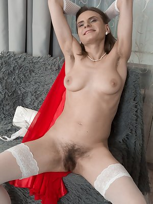 Pique Dame is 41, and enjoying putting on makeup in her red dress. She strips naked feeling sexy, and shows us her hairy pits and hairy bush. She is naturally hairy and is stunning laying back.