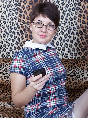 Rubina is in her plaid dress and white stockings, while sitting on her leopard couch. She strips naked, and wearing glasses makes her extra sexy. She has a very hairy pussy and she is sexy and adorable.