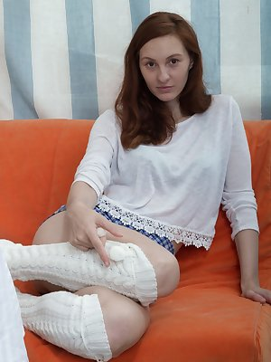 Ariadna Moon models her white top and blue skirt by her new orange sofa. She gets naked, and shows us her hairy pits, and long legs. In between her legs is her hairy pussy, and she looks elegant there.
