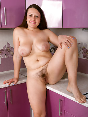 Big titted brunette mature Animee spreading hairy pussy on kitchen counter