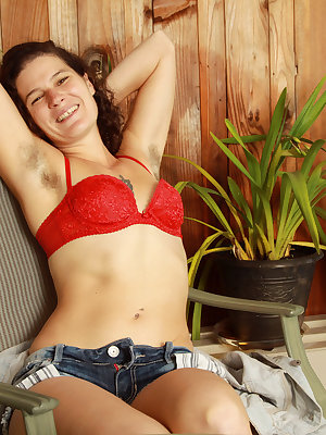 Mature lady Sunshine proudly shows off her hairy legs, armpits and beaver
