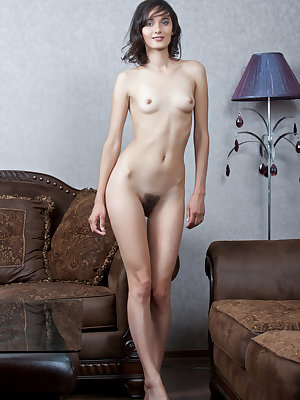 Blue eyed Chandra lounges on the couch showing her clit and hairy muff