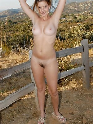 Amateur beauty Kellyq flaunts perky big tits & flashes hairy beaver outdoors