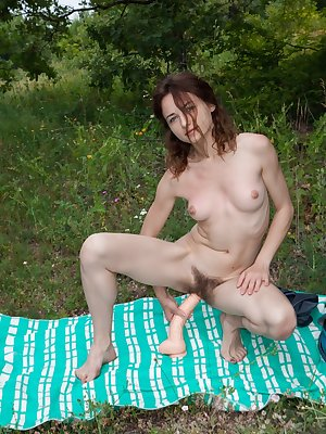 Horny little Shaya jams a big dildo in her hairy beaver on the picnic blanket