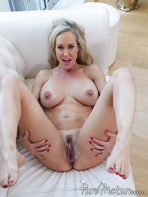 Busty mature lady Brandi Love shows off her creampie pussy after fucking