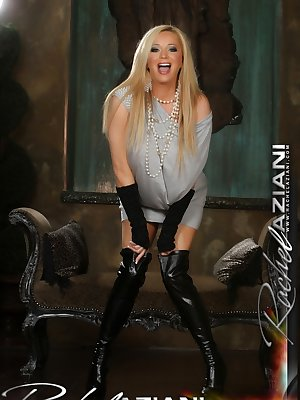 Busty blonde Rachel Aziani unveils her enormous tits and spreads in boots