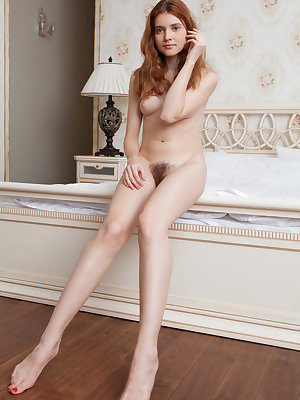 Natural redhead Orabelle Koivu displays her equally natural pussy in the nude