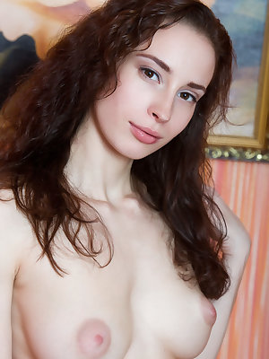 Skinny young Maja stretches and poses naked to alleviate bedroom boredom
