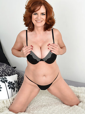 Hot redhead ature Andi James sheds sexy underwear to spread pussy close up