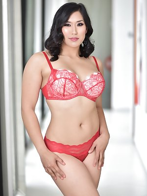 Asian curvylicious bimbo Mia Li toys her hot booty while stripping