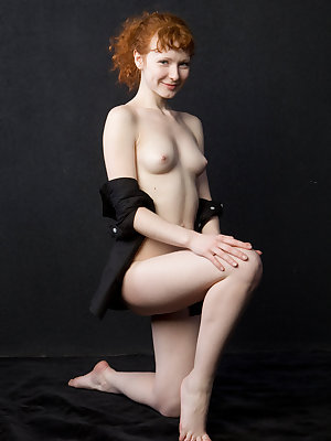 Redhead Rochelle A strips naked to prove that her carpet matches her drapes